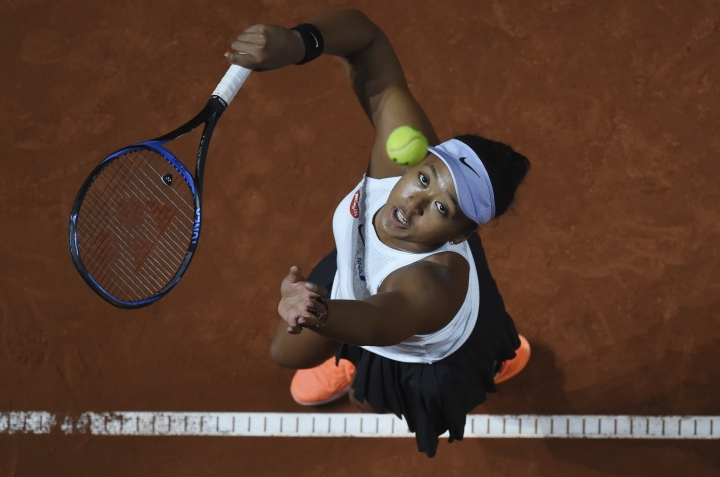 Japan's Naomi Osaka serves to Croatia's Donna Vekic during their Porsche tennis Grand Prix match in Stuttgart, Germany, Friday April 26, 2019. (Marijan Murat/dpa via AP)