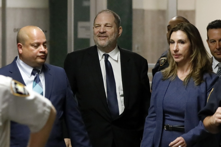 Harvey Weinstein, center, leaves State Supreme Court in New York for a lunch break, Friday, April 26, 2019. A judge decided Friday to hold a pretrial hearing in Weinstein's sexual assault case in secret, saying the former movie mogul's right to a fair trial outweighed news organizations' arguments for keeping the courtroom open. Both the prosecution and defense asked that the hearing be held behind closed doors because it focuses on sensitive matters. (AP Photo/Richard Drew)