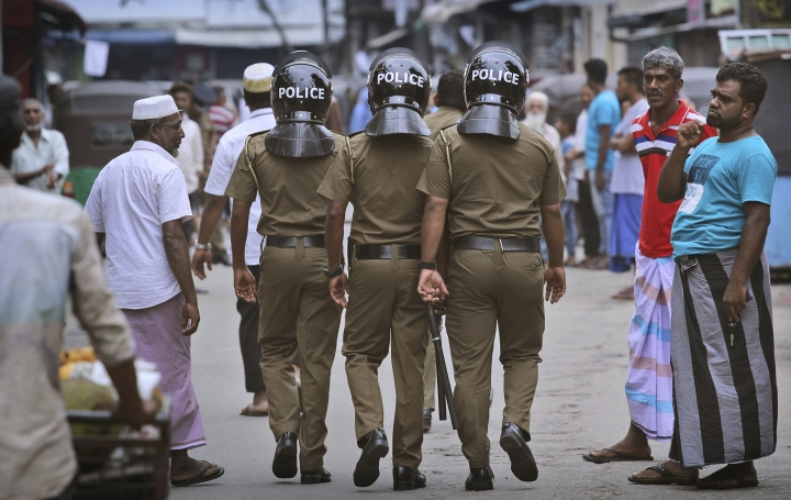 Sri Lankan policeman patrol in a Muslim neighborhood before Friday prayers in Colombo, Sri Lanka, Friday, April 26, 2019. Across Colombo, there was a visible increase of security as authorities warned of another attack and pursued suspects that could have access to explosives. Authorities had told Muslims to pray at home rather than attend communal Friday prayers that are the most important religious service for the faithful. At one mosque in Colombo where prayers were still held, police armed with Kalashnikov assault rifles stood guard outside. (AP Photo/Manish Swarup)