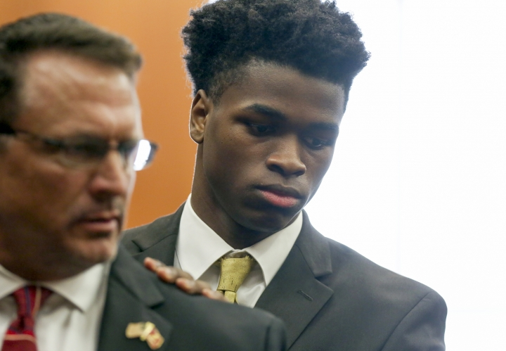 FILE - In this Tuesday, April 2, 2019 file photo, Antonio Armstrong, Jr. exits the 178th Criminal Court during a break after opening arguments in Houston. A judge has declared a mistrial in the case of the Texas teenager charged with capital murder in the shooting deaths of his mother and father, who was a standout linebacker for Texas A&M before a brief NFL career. Judge Kelli Johnson announced the mistrial Friday night, April 26, 2019, after a Harris County jury remained deadlocked for two days after hearing the weeks-long trial of 19-year-old Armstrong Jr. (Godofredo A. Vasquez/Houston Chronicle via AP, File)