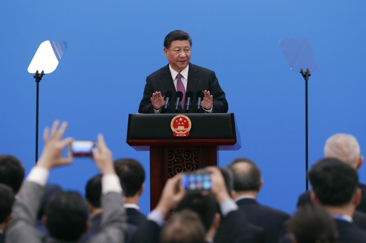 Chinese President Xi Jinping gestures as he arrives for a press conference after charing the round table summit of the Belt and Road Forum in Beijing, Saturday, April 27, 2019. Xi called Saturday for more countries to join China's sprawling infrastructure-building initiative in the face of U.S. opposition to a project Washington worries is increasing Beijing's strategic influence. (AP Photo/Mark Schiefelbein)