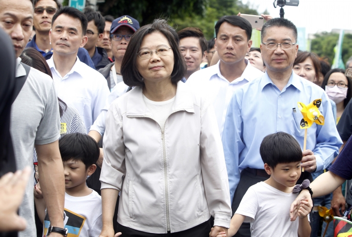Taiwan's President Tsai Ing-wen, center, holding hands of children marches during an anti-nuclear demonstration in Taipei, Taiwan, Saturday, April 27, 2019. Tsai marched in the streets of Taipei along with hundreds of anti-nuclear protesters to show her determination to build a nuclear-free homeland. (AP Photo/Chiang Ying-ying)