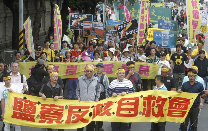 """Protesters wearing headbands reading """"Self-save Taiwan"""" march during an anti-nuclear demonstration in Taipei, Taiwan, Saturday, April 27, 2019. Taiwanese President Tsai Ing-wen reaffirmed her opposition to nuclear power before marching with the protesters. (AP Photo/Chiang Ying-ying)"""