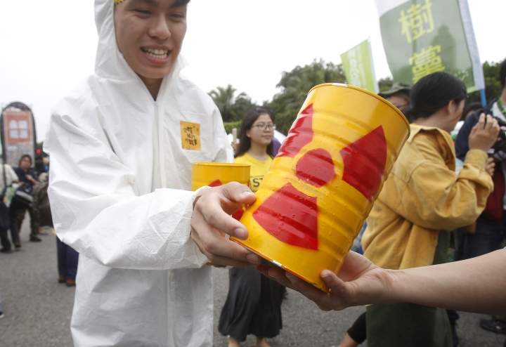 Protesters hold mock nuclear waste during an anti-nuclear demonstration in Taipei, Taiwan, Saturday, April 27, 2019. Taiwan's President Tsai Ing-wen joined in a march in the streets of Taipei along with hundreds of anti-nuclear protesters to show her determination to build a nuclear-free homeland. (AP Photo/Chiang Ying-ying)
