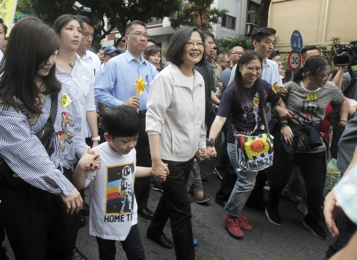 Taiwan's President Tsai Ing-wen, center, marches during an anti-nuclear demonstration in Taipei, Taiwan, Saturday, April 27, 2019. Tsai marched in the streets of Taipei along with hundreds of anti-nuclear protesters to show her determination to build a nuclear-free homeland. (AP Photo/Chiang Ying-ying)