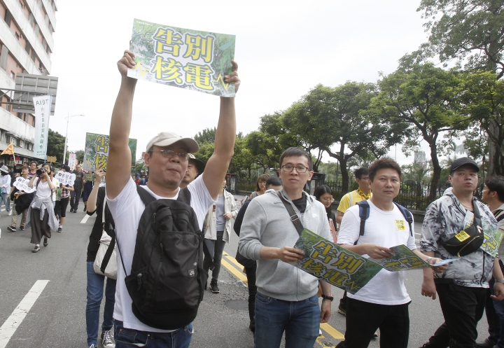 "A Taiwanese protester holds up a slogan that reads: ""Say good-bye to nuclear power"" during an anti-nuclear demonstration in Taipei, Taiwan, Saturday, April 27, 2019. Taiwan's President Tsai Ing-wen joined in a march in the streets of Taipei along with hundreds of anti-nuclear protesters to show her determination to build a nuclear-free homeland. (AP Photo/Chiang Ying-ying)"