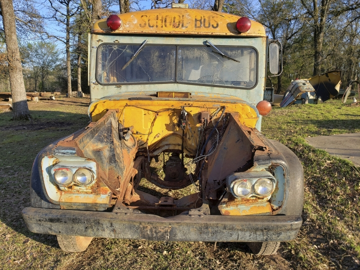 In this March 25, 2019, photo provided by Darin Swift, is a rust-eaten 1961 Chevy bus that he found driving down the road in Fruitvale, Texas. In 1971 it rambled from New Hampshire to Alaska, holding itself and a family together like a rag used for a makeshift oil cap. It's the kind of vehicle that makes people fantasize about song-filled family road trips and magic Kodachrome days when seat belts were considered optional and every stranger was just a friend you hadn't met; the kind of bus that ought to have a name. (Darin Swift via AP)