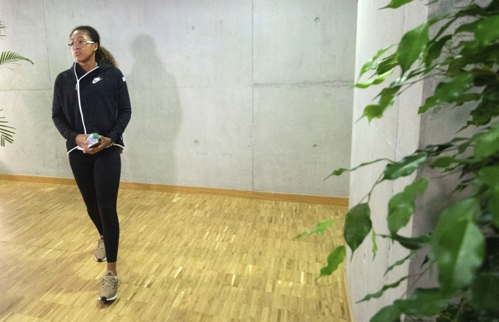Japan's Naomi Osaka arrives for a press conference at the WTA-Tour Porsche Tennis Grand Prix in Stuttgart, Germany, Saturday, April 27, 2019. (Marijan Murat/dpa via AP)