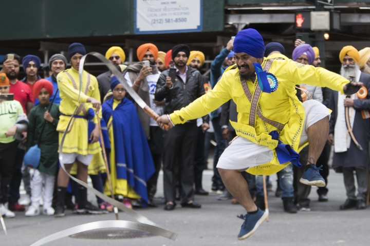 Participants practice Gatka, a martial art, as they march down Madison Avenue during the Sikh Day Parade, celebrating the Sikh holiday of Vaisakhi, Saturday, April 27, 2019, in New York. (AP Photo/Mary Altaffer)