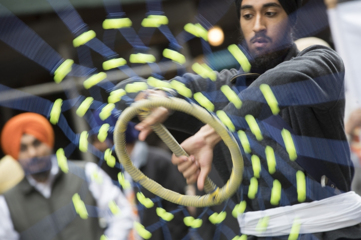 A participants twirls a Shastar, a weapon used in the martial art Gatka, during the Sikh Day Parade, celebrating the Sikh holiday of Vaisakhi, Saturday, April 27, 2019, in New York. (AP Photo/Mary Altaffer)