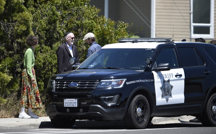 Synagogue members stand outside of the Chabad of Poway Synagogue Saturday, April 27, 2019, in Poway, Calif. Several people were injured in a shooting at the synagogue. (AP Photo/Denis Poroy)