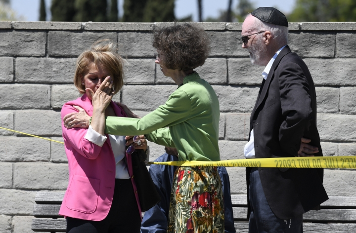 Synagogue members console one another outside of the Chabad of Poway Synagogue Saturday, April 27, 2019, in Poway, Calif. Several people were injured in a shooting at the synagogue. (AP Photo/Denis Poroy)