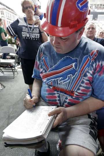 Mark Juarez, of San Jose, Calif., logs draft picks on the final day of the NFL football draft Saturday, April 27, 2019, in Nashville, Tenn. Juarez has attended every draft since 2001 and has kept his draft book since 2008. (AP Photo/Mark Humphrey)