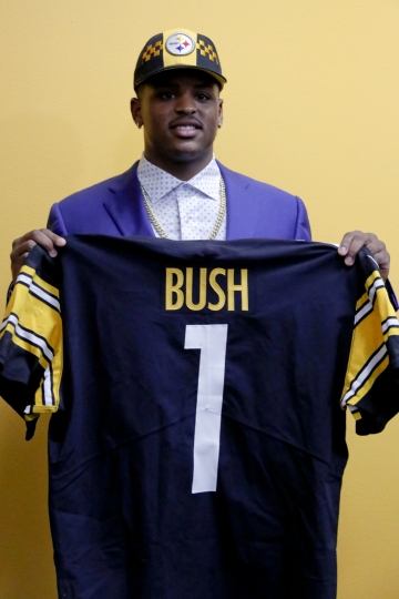 Pittsburgh Steelers first-round draft choice in the NFL Draft Devin Bush shows his draft day jersey after a news conference, Friday, April 26, 2019, in Pittsburgh. (AP Photo/Keith Srakocic)