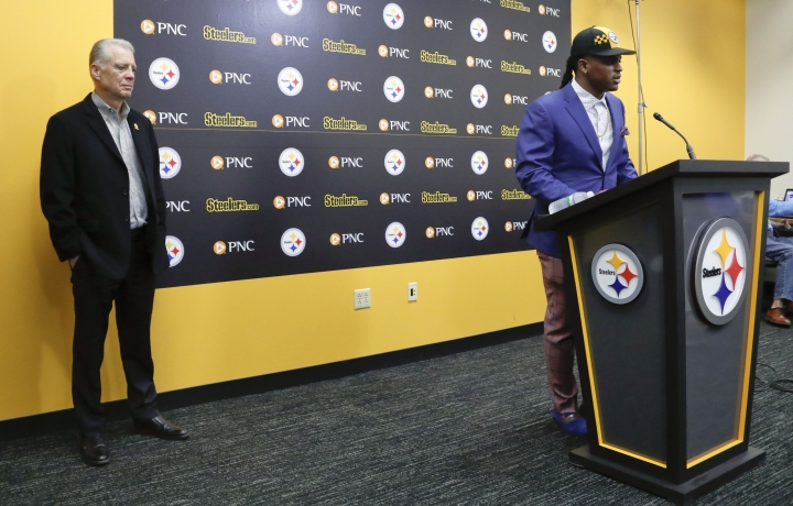 Pittsburgh Steelers first-round draft choice in the NFL Draft Devin Bush, right, answers questions beside team president Art Rooney II, left, during a football news conference, Friday, April 26, 2019, in Pittsburgh. (AP Photo/Keith Srakocic)