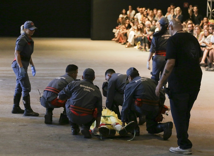 Model Tales Soares is taken from the catwalk by paramedics after he collapsed during Sao Paulo Fashion Week in Sao Paulo, Brazil, Saturday, April 27, 2019. A statement from organizers said that Soares died after taking ill while participating in the Sao Paulo's Fashion Week. (Leco Viana/Thenews2 via AP)