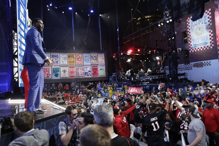 Former Dallas Cowboys player Michael Irvin speaks to fans during the third round of the NFL football draft, Friday, April 26, 2019, in Nashville, Tenn. (AP Photo/Mark Humphrey)