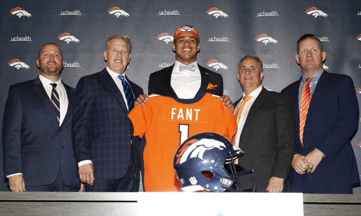 Denver Broncos' first-round selection in the NFL Draft, Noah Fant, center, a tight end out of Iowa, holds up his new jersey with, from left to right, Brian Stark, the team's director of college scouting, general manager John Elway, head coach Vic Fangio and Matt Russell, director of player personnel, during a news conference at the football team's headquarters Friday, April 26, 2019, in Englewood, Colo. (AP Photo/David Zalubowski)