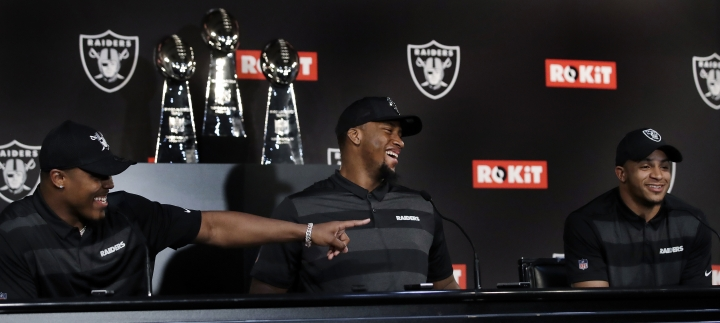 Oakland Raiders' first-round NFL draft selections, from left to right, Josh Jacobs, Clelin Ferrell and Johnathan Abram laugh during a media conference Friday, April 26, 2019, in Alameda, Calif. (AP Photo/Ben Margot)