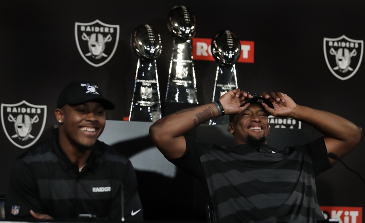 Oakland Raiders' first-round NFL draft selections Josh Jacobs, left, and Clelin Ferrell laugh during a football media conference Friday, April 26, 2019, in Alameda, Calif. (AP Photo/Ben Margot)