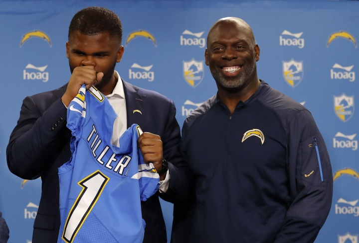 Los Angeles Chargers NFL football defensive tackle Jerry Tillery, left, suppresses a laugh as he talks with head coach Anthony Lynn, right, during a news conference at Chargers headquarters Friday, April 26, 2019, in Costa Mesa, Calif. The Notre Dame defensive tackle was drafted by the Chargers in the first round Thursday. AP Photo/Gregory Bull)