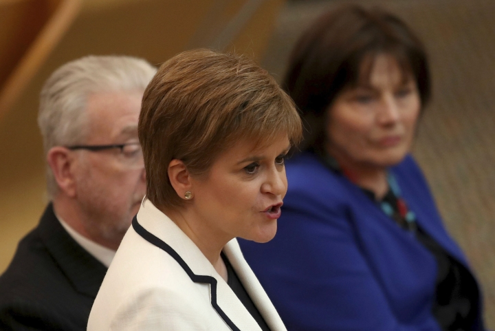 First Minister of Scotland Nicola Sturgeon issues a statement on Brexit and independence in the main chamber at the Scottish Parliament, Edinburgh, Wednesday April 24, 2019. Sturgeon says she wants to hold a new referendum on independence from the U.K. by 2021 if Britain leaves the European Union, though she acknowledges she lacks the power to make it happen on her own. Scots voted against independence by 55% to 45% in a 2014 referendum billed as a once-in-generation poll. (Jane Barlow/PA via AP)
