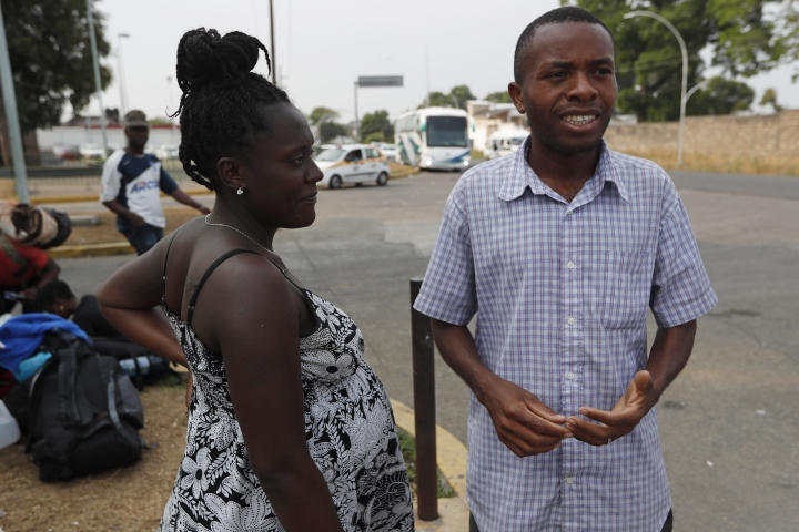"Nine-months pregnant Marc Louis Rosetanie and her husband Marc Roselin, from Haiti, stand outside an immigration detention center in Tapachula, Chiapas state, Mexico, Friday, April 26, 2019. Rosetanie, 26, and Roselin, 29, from the city of Cap Haitien, arrived just a few days ago in Mexico over the torturous Central American route. The couple is wondering who they should ask about applying for a humanitarian visa, or obstetrical care for Rosetanie. ""Soon, we will have a Mexican child,"" Roselin said. ""That may change things."" (AP Photo/Moises Castillo)"