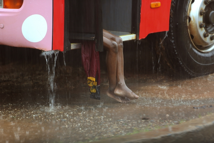 A child sits on a bus during rainfall, in Natite neighbourhood, in Pemba, on the northeastern coast of Mozambique, Sunday, April, 28, 2019. Serious flooding began on Sunday in parts of northern Mozambique that were hit by Cyclone Kenneth three days ago, with waters waist-high in areas, after the government urged many people to immediately seek higher ground. Hundreds of thousands of people were at risk. (AP Photo/Tsvangirayi Mukwazhi)