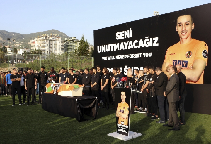 Soccer players of Alanyaspor gather for a memorial for their teammate Czech Republic's Josef Sural, in Alanya in Antalya province, Turkey, Monday, April 29, 2019. Sural was killed and six other Alanyaspor players were injured Monday when their van was involved in an accident on the way home from a Turkish league soccer match. (DHA via AP)