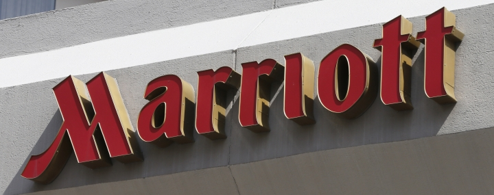 FILE - This March 23, 2016, file photo, shows a sign at a Marriott Hotel in Richmond, Va. Marriott is pushing more heavily into home-sharing, confident that its combination of luxury properties and loyalty points can lure travelers away from rivals like Airbnb. (AP Photo/Steve Helber, File)