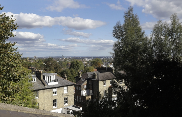 FILE - This Sept. 28, 2018, file photo shows a view from the top floor of a flat that will be available for short term rent in London. Marriott is pushing more heavily into home-sharing, confident that its combination of luxury properties and loyalty points can lure travelers away from rivals like Airbnb. Marriott has been testing in London in partnership with a home-sharing company called Hostmaker. (AP Photo/Kirsty Wigglesworth, File)