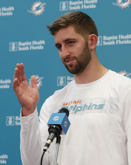 Miami Dolphins NFL football quarterback Josh Rosen gestures as he speaks during a news conference, Monday, April 29, 2019, at the Dolphins training facility in Davie, Fla. The Dolphins traded a 2019 second-round draft pick and a 2020 fifth-round selection to Arizona for Rosen. (AP Photo/Wilfredo Lee)