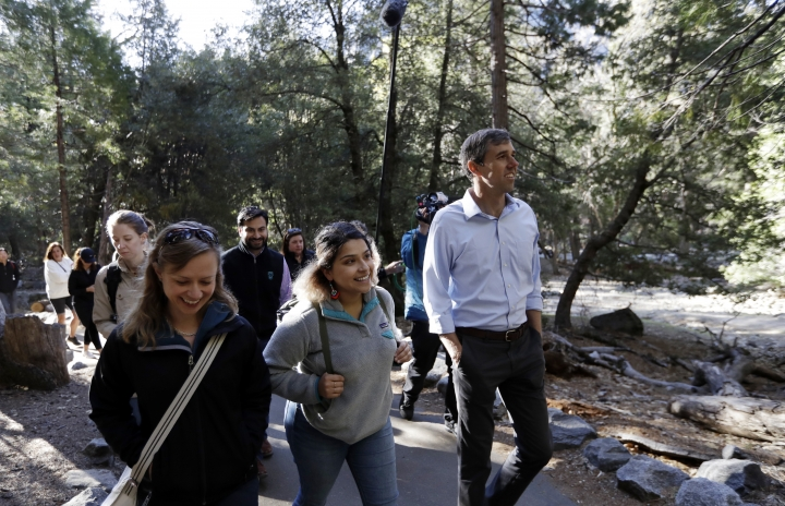 Democratic presidential candidate and former Texas congressman Beto O'Rourke, right, walks with environmental advocate Leslie Martinez, center, and Anne Kelly, Director of the Sierra Nevada Research Stations, Monday, April 29, 2019, in Yosemite National Park, Calif. (AP Photo/Marcio Jose Sanchez)