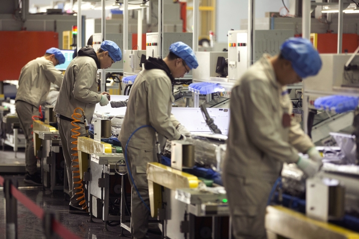 FILE - In this Friday, Feb. 24, 2017, file photo, factory workers assemble the cases of air conditioners on an assembly line at a factory in Jiaozhou, eastern China's Shandong Province. Two surveys show Chinese factory activity grew in April but below the previous month's pace amid a tariff battle with Washington. (AP Photo/Mark Schiefelbein, File)