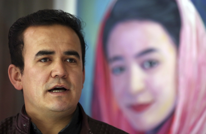 In this Tuesday, March 19, 2019, photo, Hameed Rafi, brother of Rahila, who was killed in a suicide bombing, speaks during an interview with the Associated Press at a library dedicated to his sister's memory, in Kabul, Afghanistan. (AP Photo/Rahmat Gul)