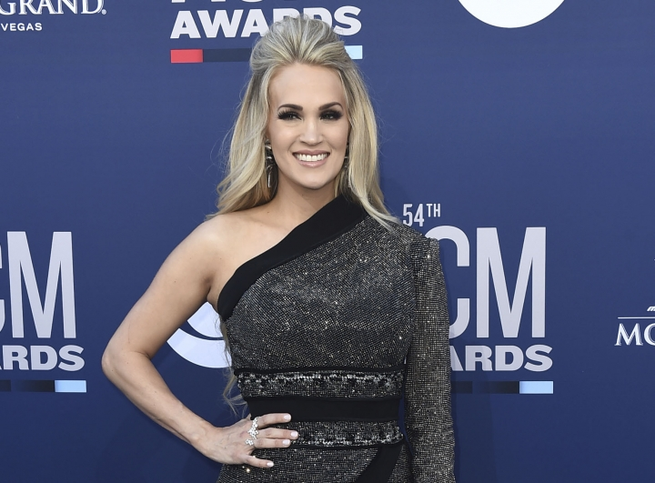 FILE - This April 7, 2019 file photo shows Carrie Underwood at the 54th annual Academy of Country Music Awards in Las Vegas. Underwood has picked opening acts Maddie & Tae and Runaway June to open for her arena tour that starts May 1 in Greensboro, N.C. (Photo by Jordan Strauss/Invision/AP, File)