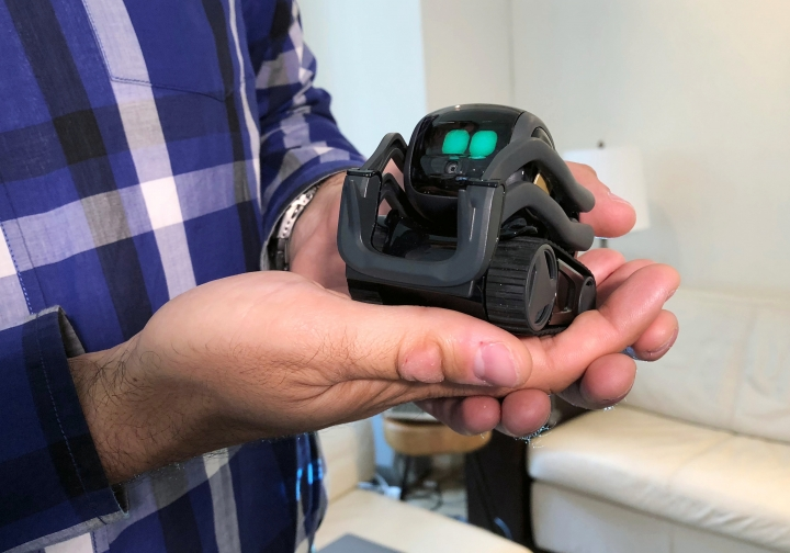 FILE - In this July 30, 2018, file photo, Anki Inc. CEO Boris Sofman holds Vector, the company's new home robot, in New York. The wheeled robot is designed as a successor to the San Francisco company's toy robot, Cozmo, which was introduced in 2016. Hopes that the tech industry was on the cusp of rolling personal robots into homes are dimming now that several once-promising consumer robotics companies have shut down. (AP Photo/Ted Shaffrey, File)
