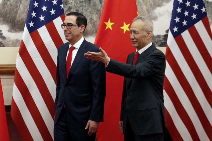 Chinese Vice Premier Liu He, right, shows the way to U.S. Treasury Secretary Steven Mnuchin as they proceed to their meeting at the Diaoyutai State Guesthouse in Beijing, Wednesday, May 1, 2019. (AP Photo/Andy Wong, Pool)