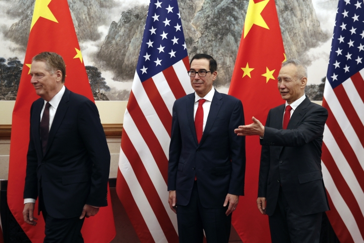 Chinese Vice Premier Liu He, right, shows the way to U.S. Treasury Secretary Steven Mnuchin, center, and U.S. Trade Representative Robert Lighthizer, left, as they proceed to their meeting at the Diaoyutai State Guesthouse in Beijing, Wednesday, May 1, 2019. (AP Photo/Andy Wong, Pool)