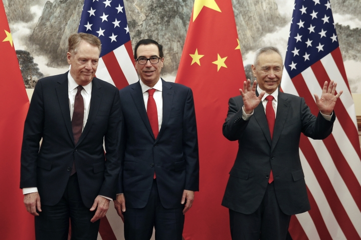 Chinese Vice Premier Liu He, right, gestures as U.S. Treasury Secretary Steven Mnuchin, center, chats with his Trade Representative Robert Lighthizer, left, before they proceed to their meeting at the Diaoyutai State Guesthouse in Beijing, Wednesday, May 1, 2019. (AP Photo/Andy Wong, Pool)
