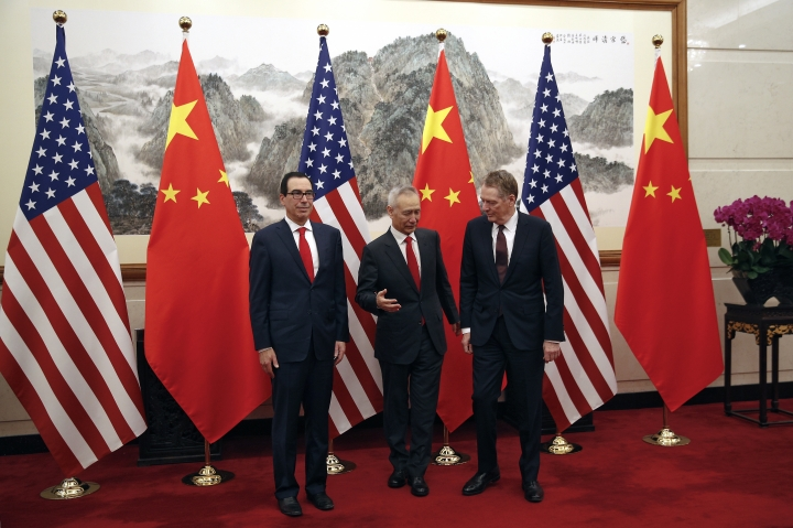 Chinese Vice Premier Liu He, center, chats with U.S. Trade Representative Robert Lighthizer, right, next to U.S. Treasury Secretary Steven Mnuchin, left, before they proceed to their meeting at the Diaoyutai State Guesthouse in Beijing, Wednesday, May 1, 2019. (AP Photo/Andy Wong, Pool)