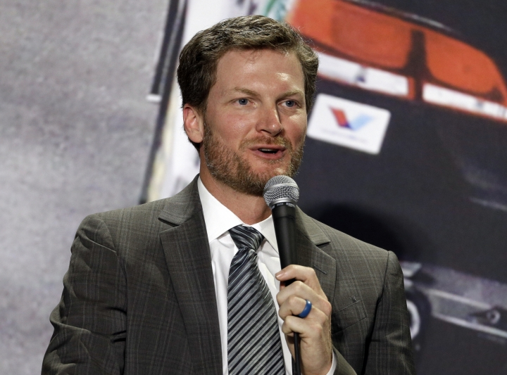 FILE - In this April 25, 2017, file photo, Dale Earnhardt Jr. speaks during a news conference at Hendrick Motorsports in Concord, N.C. Earnhardt Jr. will work his first Kentucky Derby on Saturday, May 4, 2019, as part of his expanding role with NBC Sports. The retired NASCAR superstar is also slated to cover his first Indianapolis 500 later this month. (AP Photo/Chuck Burton, File)