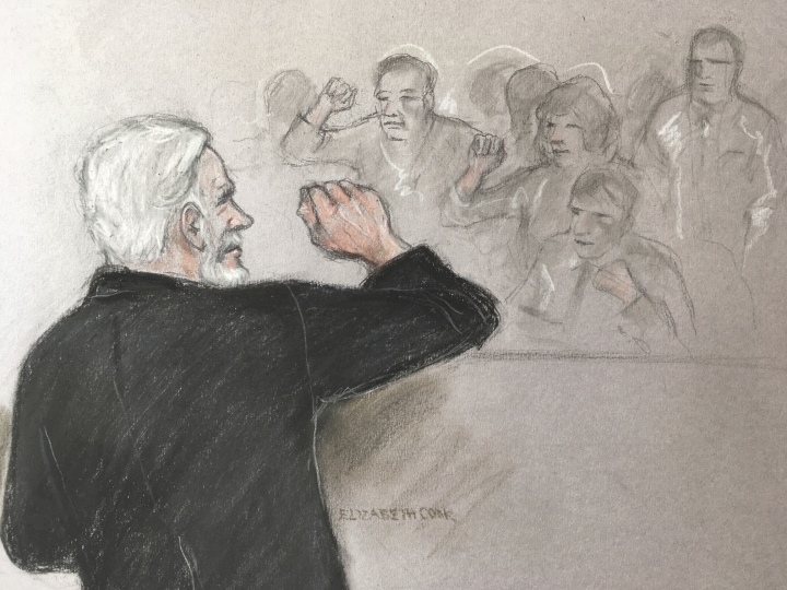 Court artist sketch by Elizabeth Cook, depicting Julian Assange, left, saluting his supporters as he appears at Southwark Crown Court in London for breaching his bail, Wednesday May 1, 2019. Assange has been jailed for 50 weeks for breaching his bail after going into hiding in the Ecuadorian embassy in London. (Elizabeth Cook/PA via AP)