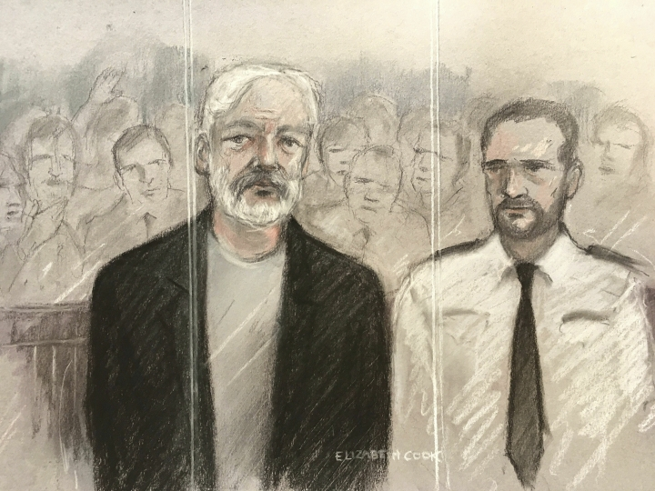 Court artist sketch by Elizabeth Cook, depicting Julian Assange, left, as he appeared at Southwark Crown Court in London for breaching his bail, Wednesday May 1, 2019. Assange has been jailed for 50 weeks for breaching his bail after going into hiding in the Ecuadorian embassy in London. (Elizabeth Cook/PA via AP)