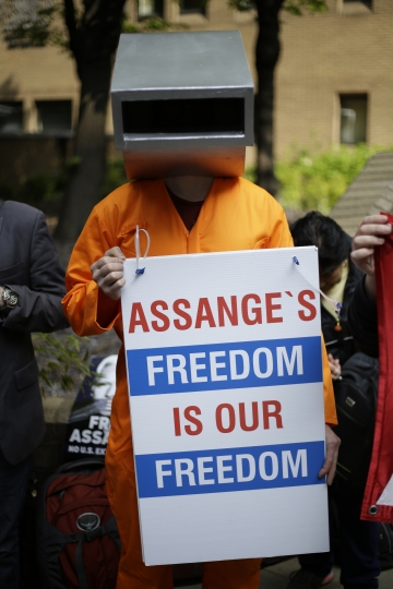 Protesters outside court as Julian Assange will appear to be sentenced on charges of jumping British bail seven years ago, in London, Wednesday May 1, 2019. Founder of WikiLeaks whistleblower site, Assange faces a separate court hearing later, on a U.S. extradition request, after being arrested at the Ecuadorian embassy April 11, when his political asylum was withdrawn. (AP Photo/Matt Dunham)