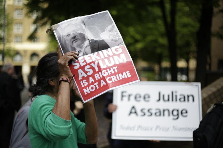 Protesters outside court as WikiLeaks founder Julian Assange will appear in court to be sentenced on charges of jumping British bail seven years ago, in London, Wednesday May 1, 2019. Assange was arrested at the Ecuadorian embassy April 11, after his political asylum was withdrawn. (AP Photo/Matt Dunham)