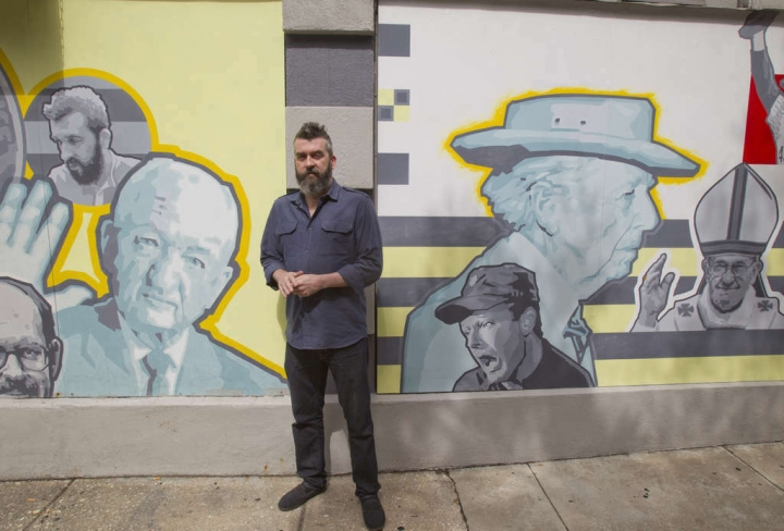 In this Nov. 11, 2015 photo, Frank Sherlock, the then-poet laurel of Philadelphia, poses outside Dirty Franks, a bar in Philadelphia where he worked as a bouncer. Sherlock, who focused on bringing poetry to neighborhoods and the city's young people, has been outed as a former white nationalist. He was appointed to the year-long post in 2014 during the administration of Mayor Michael Nutter, who is black. In the late 1980s, Sherlock was a 19-year-old skinhead and vocalist for a white nationalist punk band called New Glory. (Charles Fox/The Philadelphia Inquirer via AP)