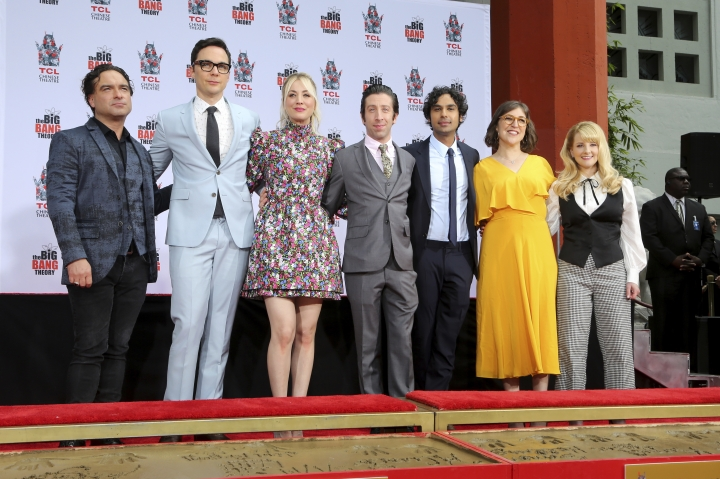 "Johnny Galecki, from left, Jim Parsons, Kaley Cuoco, Simon Helberg, Kunal Nayyar, Mayim Bialik and Melissa Rauch, cast members of the TV series ""The Big Bang Theory,"" pose at a hand and footprint ceremony at the TCL Chinese Theatre on Wednesday, May 1, 2019 at in Los Angeles. (Photo by Willy Sanjuan/Invision/AP)"