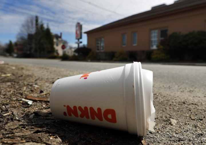 A coffee cup made from polystyrene foam, commonly known as Styrofoam, lies on the side of a road, Wednesday, May 1, 2019, in Augusta, Maine. Gov. Janet Mills signed a bill into law Tuesday, April 30 making Maine one of the first states to ban single-use containers made from polystyrene foam. (AP Photo/Robert F. Bukaty)