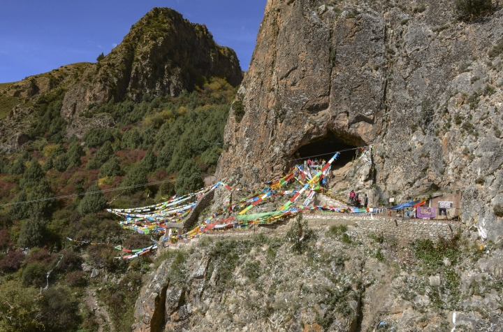 This undated photo made available by Dr. Dongju Zhang of Lanzhou University in April 2019 shows the Baishiya Karst Cave above the Jiangla riverbed in the Gansu province of China. It is both a locally famous Buddhist cave and a tourist site. According to a report released on Wednesday, May 1, 2019, a jawbone fragment found in the cave is least 160,000 years old, and recovered proteins led scientists to conclude it came from a Denisovan, a relative of Neanderthals. (Dongju Zhang/Lanzhou University via AP)